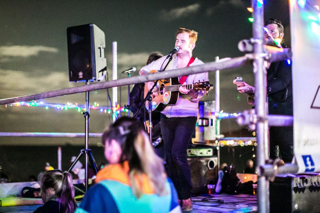 Musician Playing Guitar and Singing at Fireworks Night 2017